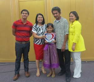 Jairuz of Abra Province receives her award together with her father and RPC Irene Bungay