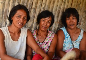 Milagros Bumutaw (center) has gained the trust of other women in their community. She also serves as insipration to them