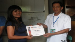 An intern from Apayao receiving her certificate for participating in the said program.  Some interns under the GIP have been deployed in the provinces. (File Photo)