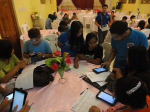 Listahanan Regional Information and Technology Officer Mark Anthony Gapoy assists the enumerators in using the tablet computers to lessen possible difficulties in the use of such during the field assessment.